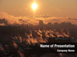 Sunset industrial buildings smog