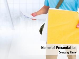 Mid section of delivery man with document against white