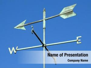 Weather vane and blue sky