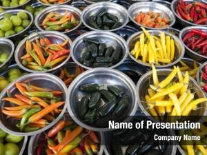 Hot peppers different varieties is on the plates on the counter market
