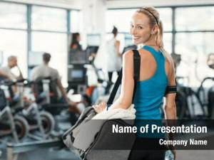 Fit woman holding gym bag in a fitness centre