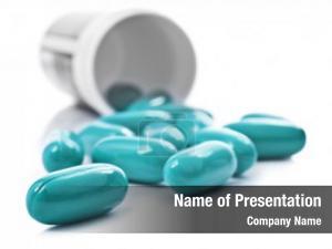 Blue pills an pill bottle on white