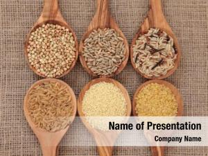 Cereal and grain selection of bulgur wheat, buckwheat, couscous, rye grain and brown and wild rice in olive wood spoons on hessian sacking