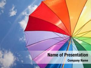 Rainbow umbrella on sky