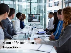 Business people looking at a screen during a video conference in the conference room