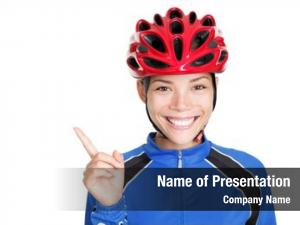 Bike woman wearing bicycle helmet pointing at copy space  on white