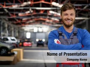 Cheerful serviceman in a car workshop