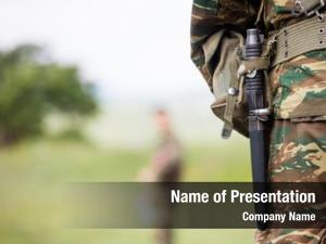 Soldier' body who standing with camouflage clothing and knife in his belt