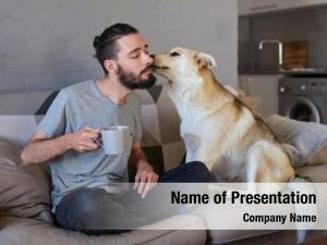 Receiving pet owner kiss lick