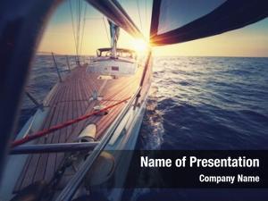 Deck sunset sailboat while cruising