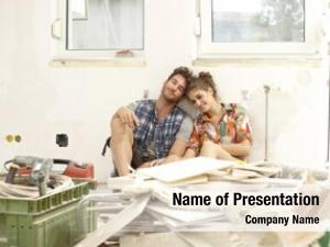 Sitting young couple exhausted house