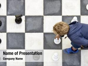 Moving young boy white pawn