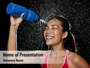Runner woman fitness drinking splashing