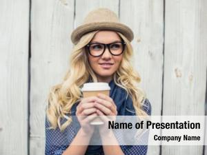 Blonde pensive fashionable holding coffee