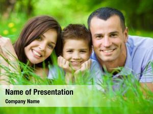 Three happy family lying grass