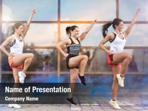 Girls three athletic doing aerobic