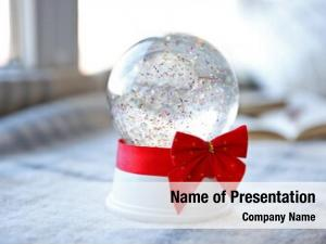 Red snow globe bow beside
