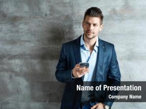 Young successful good looking businessman mobile