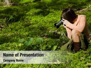 Female young pretty photographer nature