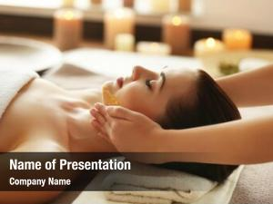 Enjoying young woman facial massage