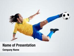 Kicking soccer player ball towards