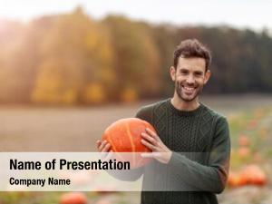 Man happy young holding pumpkin