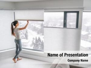 Home woman opening curtains urban
