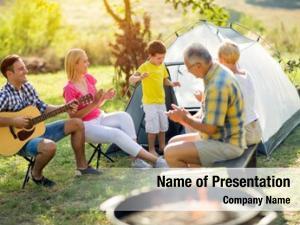Smiling child singing family camping