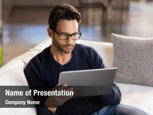 Digital man using tablet sofa