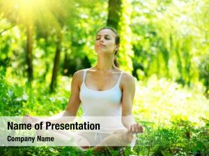 Doing young woman yoga exercises