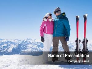 Standing skier couple snowy mountain