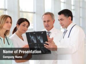 Nurses group doctors looking x ray