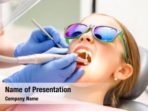 Performing dental hygienist teeth cleaning
