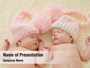 Identical sleeping newborn boy twins