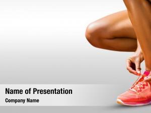 Lacing close sportswoman shoes against
