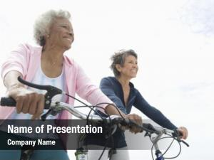 Riding middle aged woman bicycle