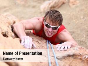 Rock male climber climbing cliff