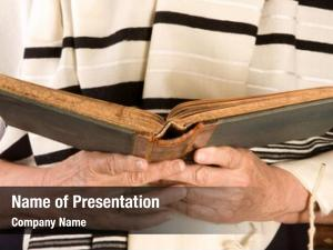 Jewish hands holding prayer book
