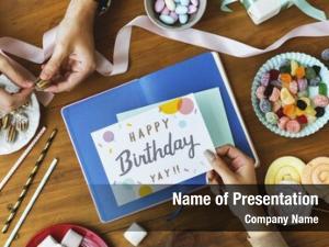 Birthday hand holding wish card