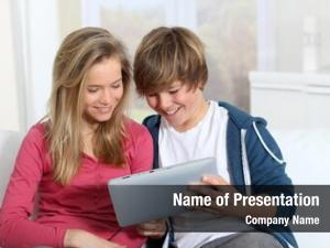Using young teenagers electronic tablet