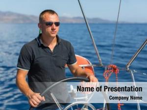 Helm man skipper sail boat,