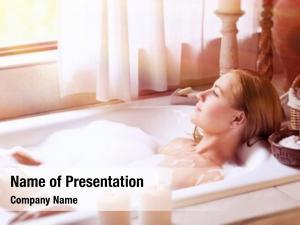 Lying beautiful woman down bath