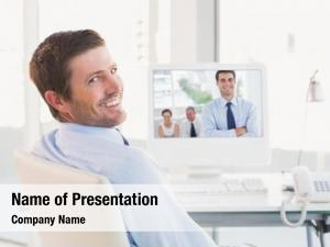 Posing cheerful businessman while his