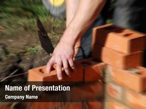 Laying construction worker bricks wall