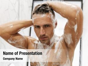 Man close concentrated having shower