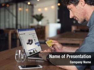 Using senior businessman debit card
