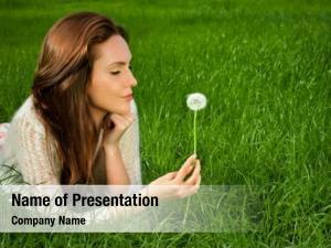 Green girl dandelionson field
