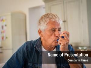 Using senior man asthma inhaler