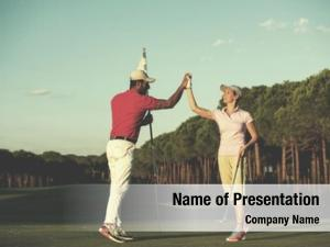 Instructor male golf teaching female
