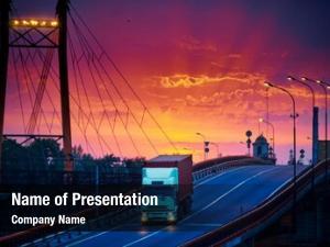 Rides truck container over bridge,